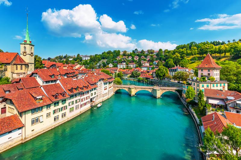 Summer view of Bern, Switzerland. Scenic summer view of the Old Town architecture of Bern with the bridge Untertorbryukke over Aare river, Berne, Switzerland royalty free stock images