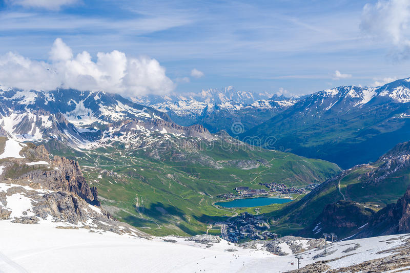 Summer view of the Grand Motte glacier. On settlements Val Claret and Le Lac, chair lift and the surrounding mountains. Tignes, French Alps royalty free stock image