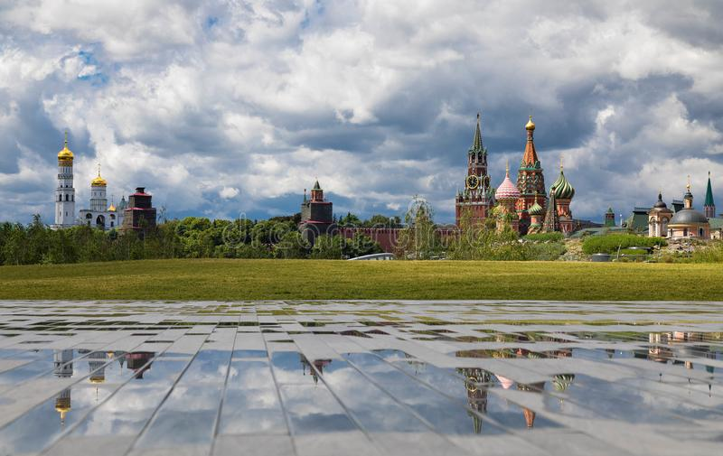 View from the hill of the Zaryadye park on church Ivan the Great Bell Tower and reflections. Cloudy weather with thunderclouds on. Summer View from the hill of stock photos