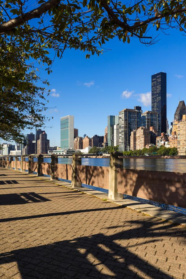 Manhattan Midtown East skyscrapers from Roosevelt Island with the East River. New York City. Summer view on Manhattan Midtown East skyscrapers from Roosevelt royalty free stock image