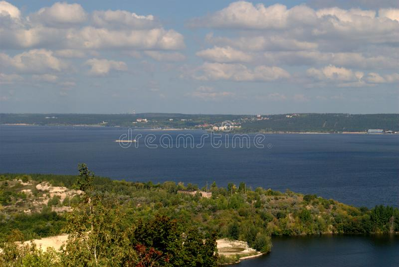 Summer view from the mountain Otvazhnaya on the Volga River and high-rise buildings of the city of Togliatti on the opposite bank. Summer view from the mountain stock image