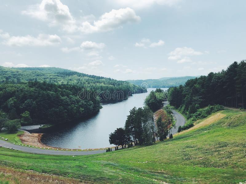 Summer view from Saville Dam. In Connecticut near Barkhamsted Reservoir and Farmington River in Connecticut United States royalty free stock images