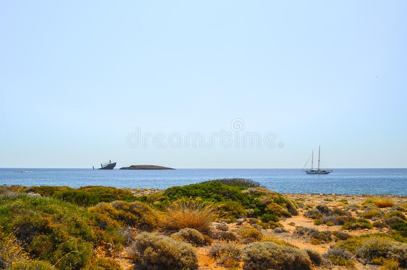 Ship wreck `Nordland` and yacht, Diakofti Kythera, Greece. royalty free stock photos