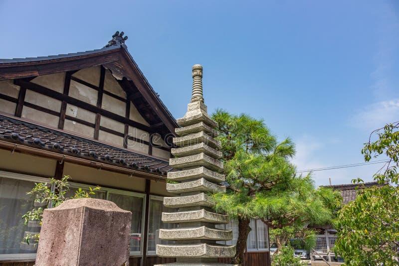 Summer view of stone sekitou, or stupa, or Japanese Pagoda, with pine trees at Honteruyamahoko Buddhist temple in Kanazawa, stock photos