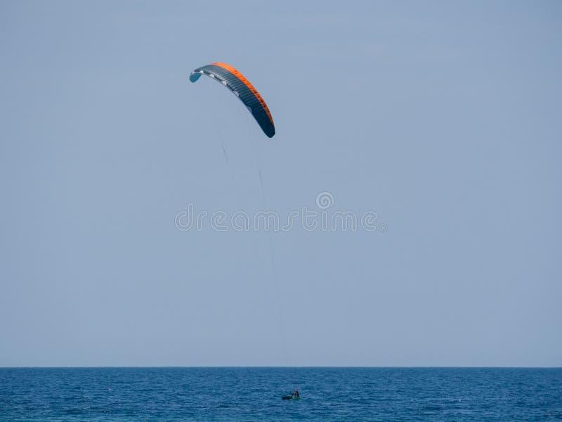 Summer water sports in clear open sea ocean. Summer water sports kite surfing wind surfing in clear sea ocean stock images
