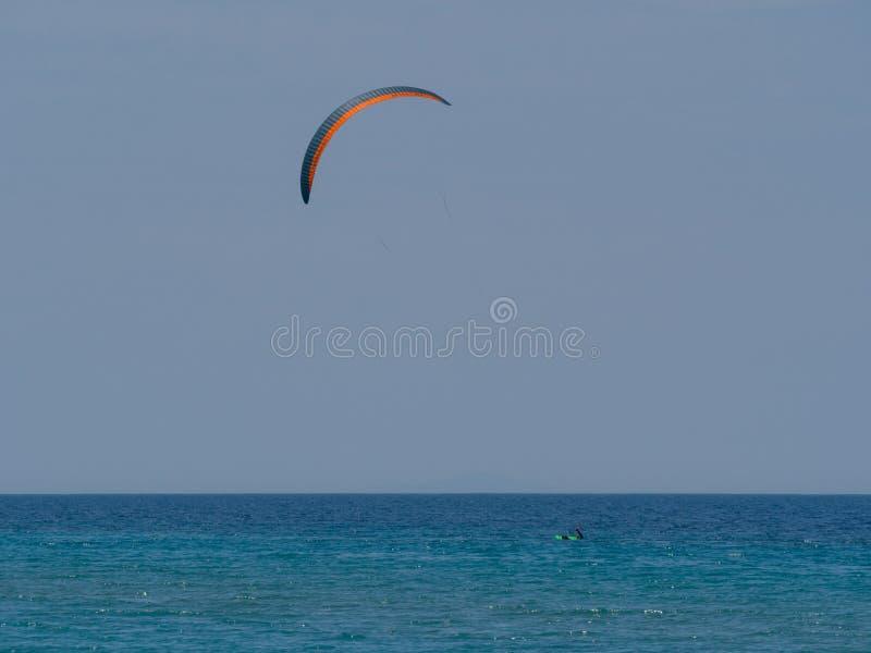 Summer water sports in clear open sea ocean. Summer water sports kite surfing wind surfing in clear sea ocean royalty free stock image