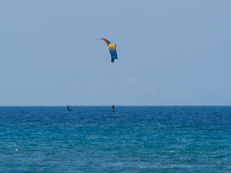 Summer water sports in clear open sea ocean. Summer water sports kite surfing wind surfing in clear sea ocean royalty free stock photo