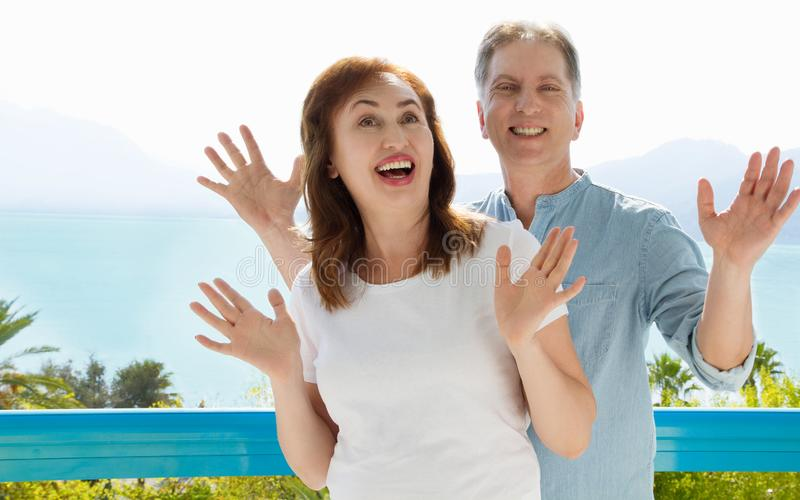 Summer white t shirt template. Happy middle aged family couple at vacation. Beach and holiday concept. Copy space and mock up royalty free stock photography