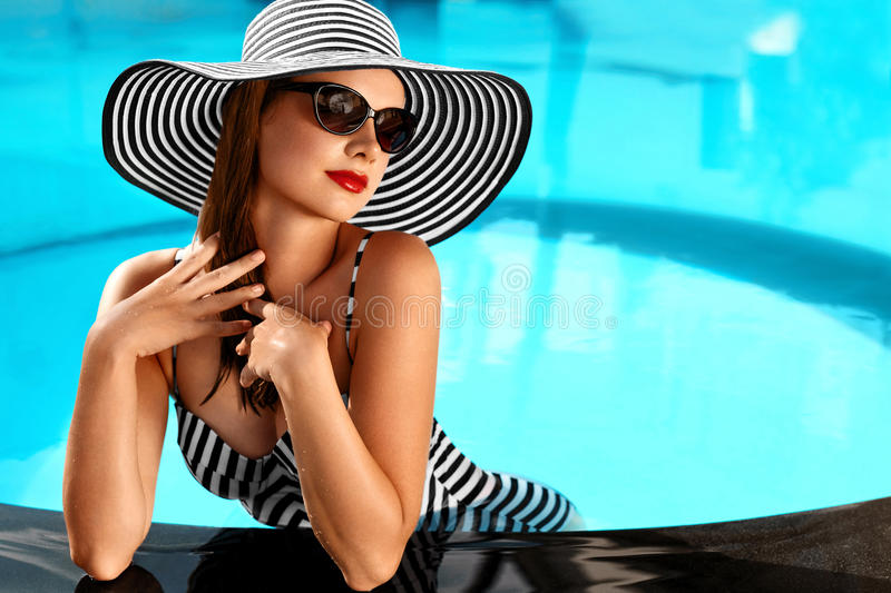Summer Woman Beauty, Fashion. Healthy Woman In Swimming Pool. Re. Summer Woman Beauty, Fashion. Beautiful Healthy Woman With Body In Elegant Bikini, Sun Hat royalty free stock photography