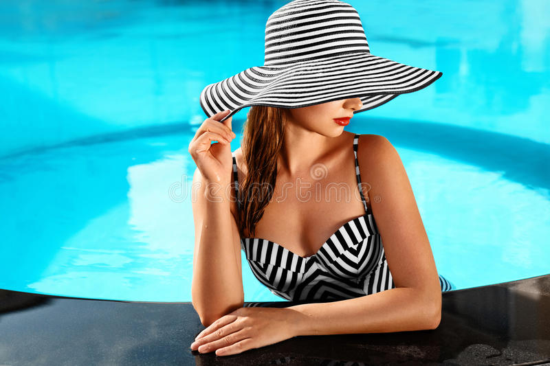 Summer Woman Body Care. Relaxation In Swimming Pool. Holidays Va royalty free stock photo