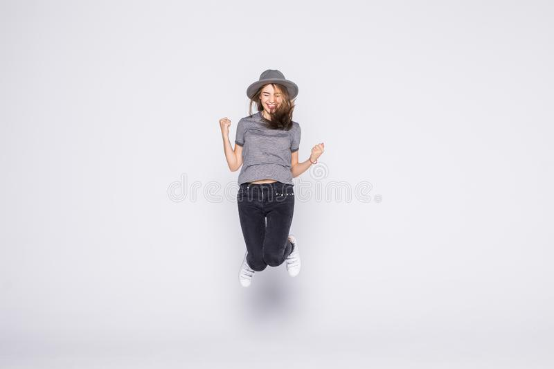 Summer woman jumping of joy excited isolated on white background. Summer woman jumping of joy excited. Beautiful mixed race woman isolated on white background stock photos