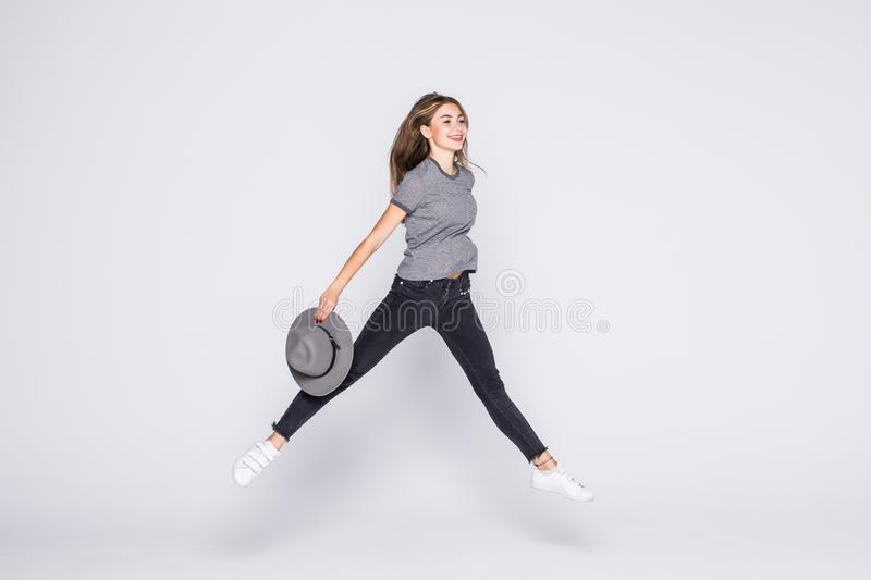 Summer woman jumping of joy excited isolated on white background. Summer woman jumping of joy excited. Beautiful mixed race woman isolated on white background stock image