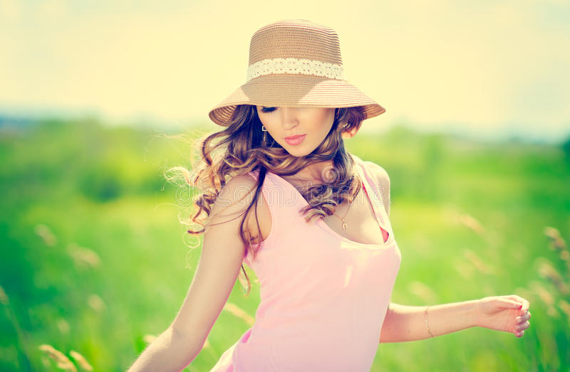Summer woman portrait. Beautiful happy woman in hat on summer meadow stock images