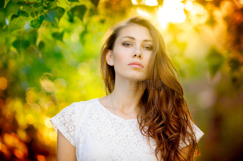 Summer woman portrait. Outdoors summer portrait of beautiful woman on sunset royalty free stock photo