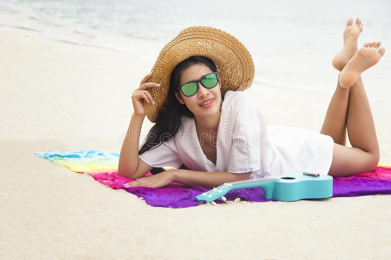 Summer woman relaxing in hipster beach hat and colorful sunglasses. Funky happy girl having fun during travel holidays vacation. Young trendy cool hipster stock photo