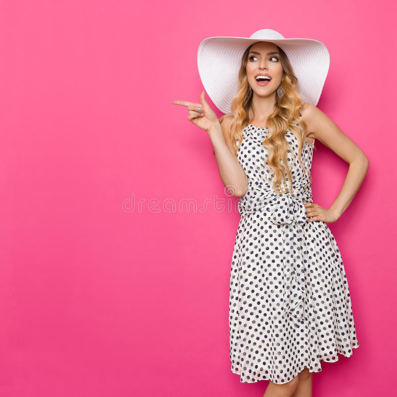 Summer Woman In Sun Hat Is Pointing And Talking royalty free stock photos