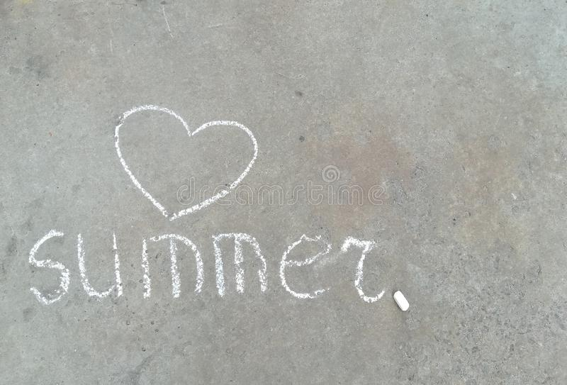 Summer word and heart - white chalk hand drawing on black asphalt stock photos