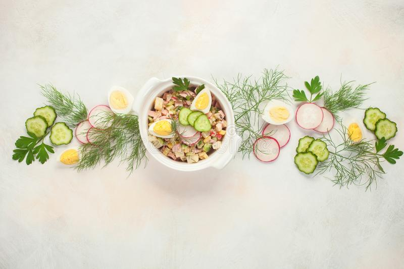 Russian Okroshka. Summer yoghurt cold soup with radish, cucumber, and dill on wooden table. Russian Okroshka. Top view royalty free stock images
