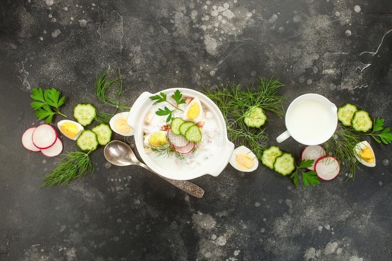 Russian Okroshka. Summer yoghurt cold soup with radish, cucumber, and dill on wooden table. Russian Okroshka. Top view stock photo