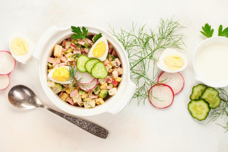 Russian Okroshka. Summer yoghurt cold soup with radish, cucumber, and dill on wooden table. Russian Okroshka. Top view royalty free stock photos
