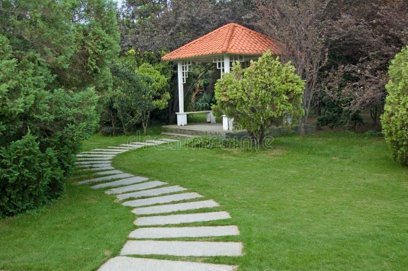 Summerhouse and walkway royalty free stock image