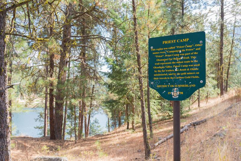 Sign marking the historic site of Priest Camp on Garnet Lake near Summerland, BC, Canada. Summerland, British Columbia/Canada - August 25, 2017: a sign marks the stock photos