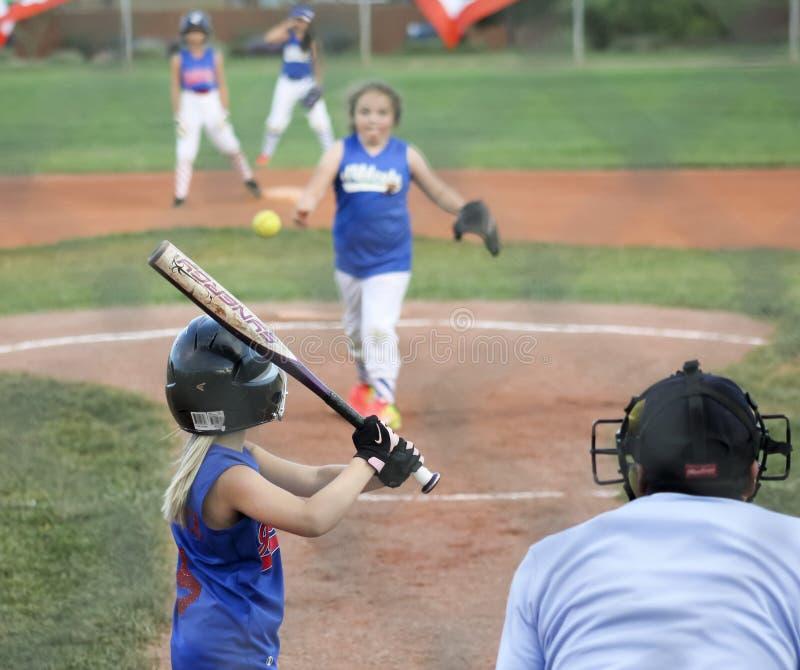A Summerlin Little League Girls Softball Game. SUMMERLIN, NEVADA - JUNE 4: A Summerlin Little League girls game on June 4, 2015, in Summerlin, Nevada. The batter royalty free stock photos