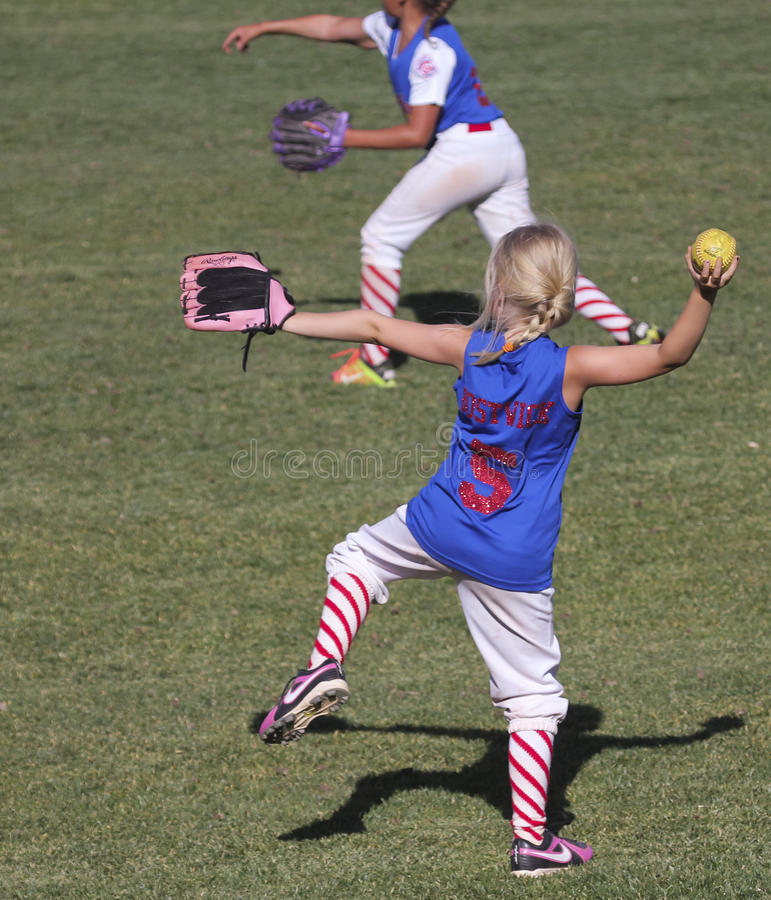 A Summerlin Little League Girls Softball Game. SUMMERLIN, NEVADA - JUNE 4: A Summerlin Little League girls game on June 4, 2015, in Summerlin, Nevada. Two royalty free stock image