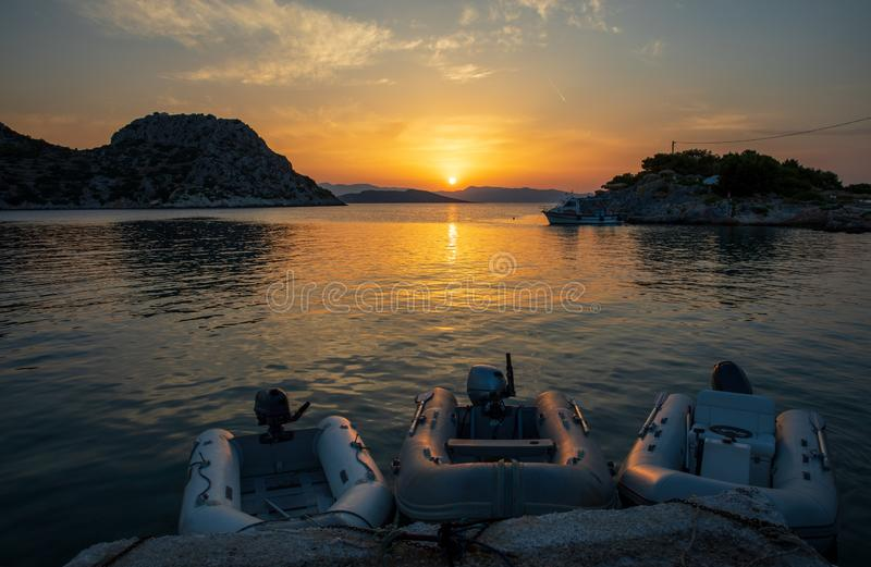 Summertime beautiful sunset as seen from the beach of Aponissos, Agistri island, Saronic gulf, Greece. Horizontal royalty free stock photography