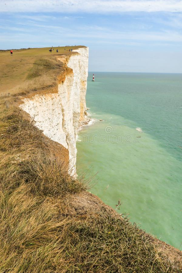 Summertime coastal path along cliffs. The coastal path from Eastbourne to East Dean, across the highest chalk cliffs in the United Kingdom stock photos