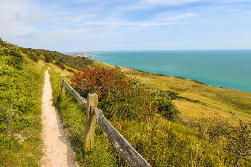 Summertime coastal path along cliffs. The coastal path from Eastbourne to East Dean, across the highest chalk cliffs in the United Kingdom royalty free stock photography
