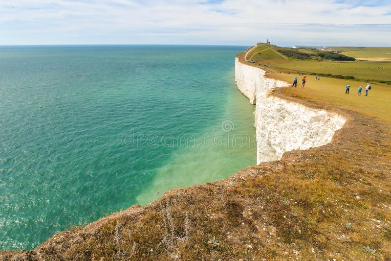Summertime coastal path along cliffs. The coastal path from Eastbourne to East Dean, across the highest chalk cliffs in the United Kingdom stock images