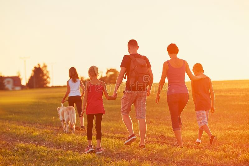 Family with dog on the trip royalty free stock image