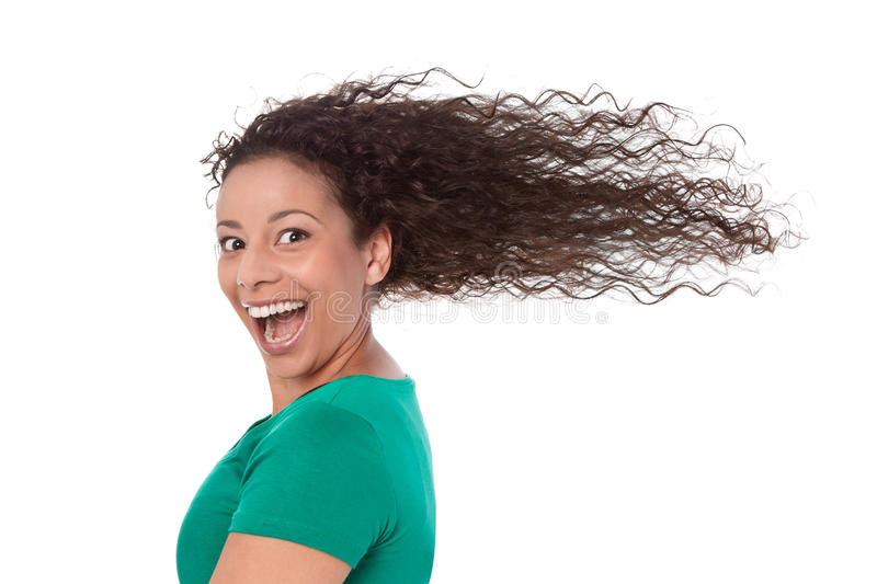 Summertime: Crazy woman in green with blowing hair in wind isolated. royalty free stock photos