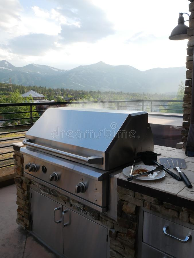 Summertime grilling. Patio grill with colorado mountains in the background stock photos