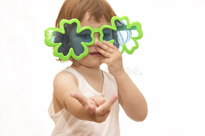 Summertime kid. Little girl, wearing funny, clover shaped, sunglasses, isolated on white stock photography