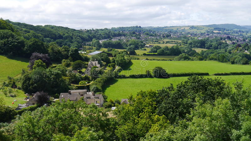 Summertime landscape scene in The Cotswolds England. A countryside scene typical of the Cotswold Hills in Gloucestershire England in summertime royalty free stock images