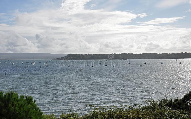 Poole harbour in the summertime. A summertime scene along Poole harbour in Dorset, UK stock photography