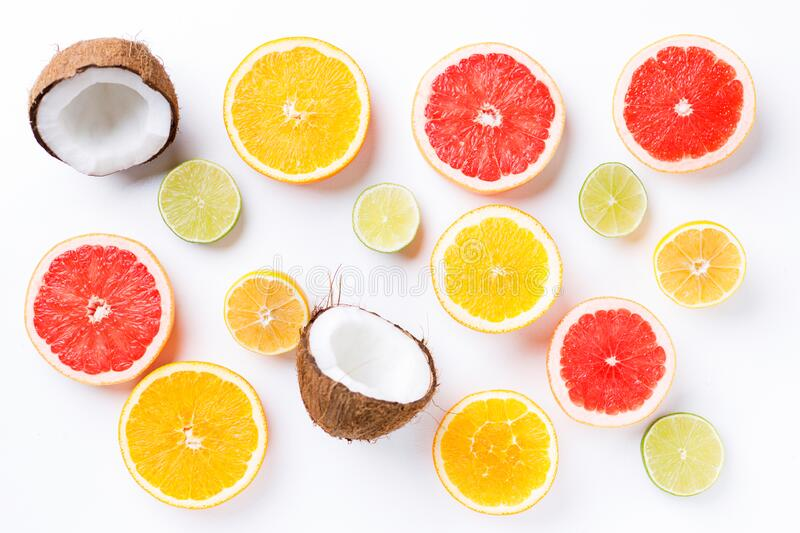 Summertime tropical background with exotic fruits stock images
