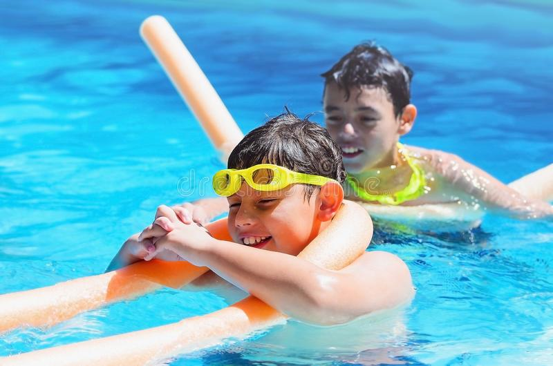 Summertime, two boys having a good time at the swimming pool stock photos