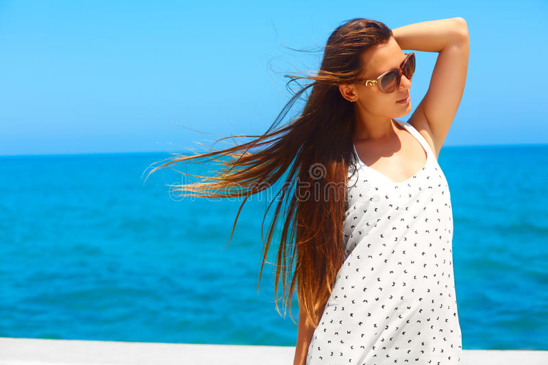 Summertime vacation. Woman by the sea. royalty free stock photography