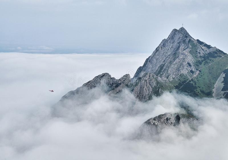 Giewont mountain massif above the fog royalty free stock image