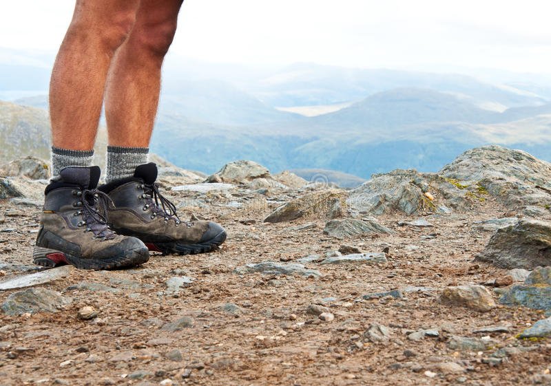On the summit. Hiking shoes on the summit in Scotland stock photos