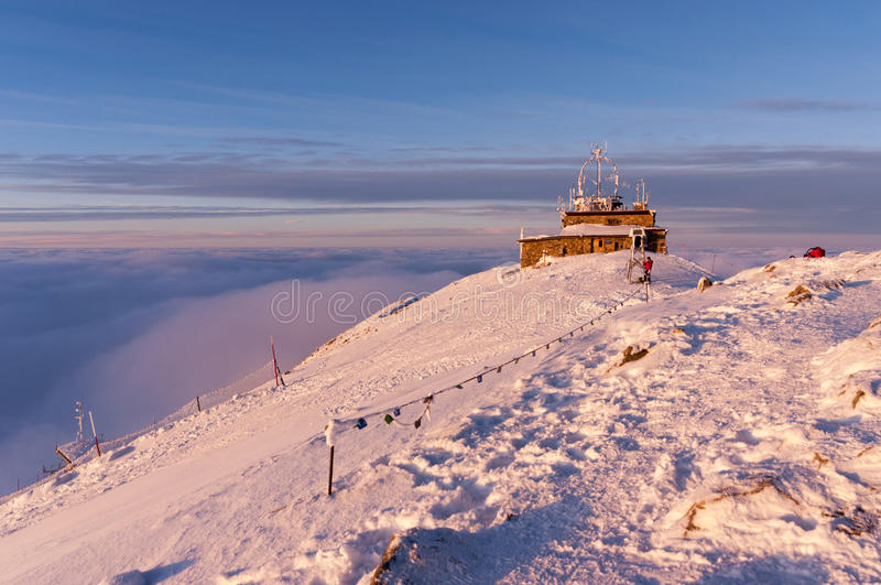 The summit of Kasprowy Wierch during sunset and inversion. Tatry. Poland.  stock images