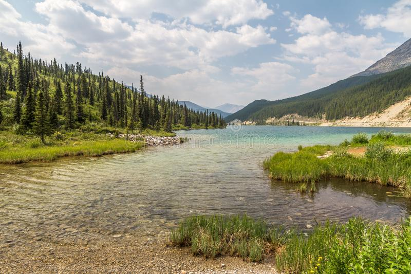 Clear, turqouise waters of Summit Lake, Northern Rocky Mountains, BC royalty free stock image