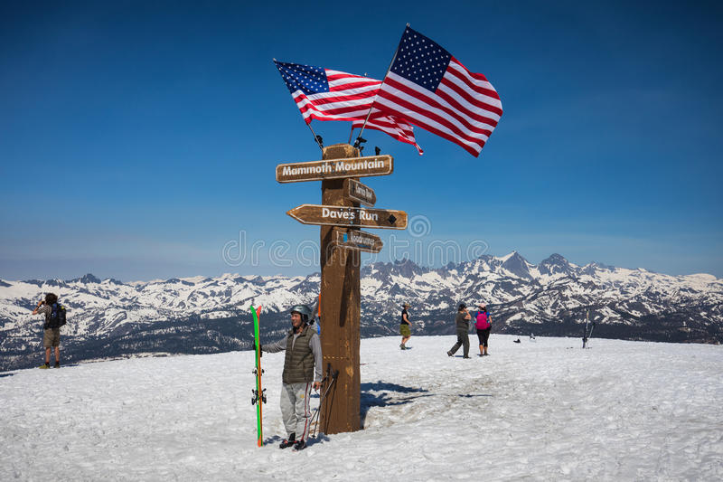Summit of Mammoth mountain. People near the signpost on top of Mammoth mountain, Sierra Nevada range, California n royalty free stock photos