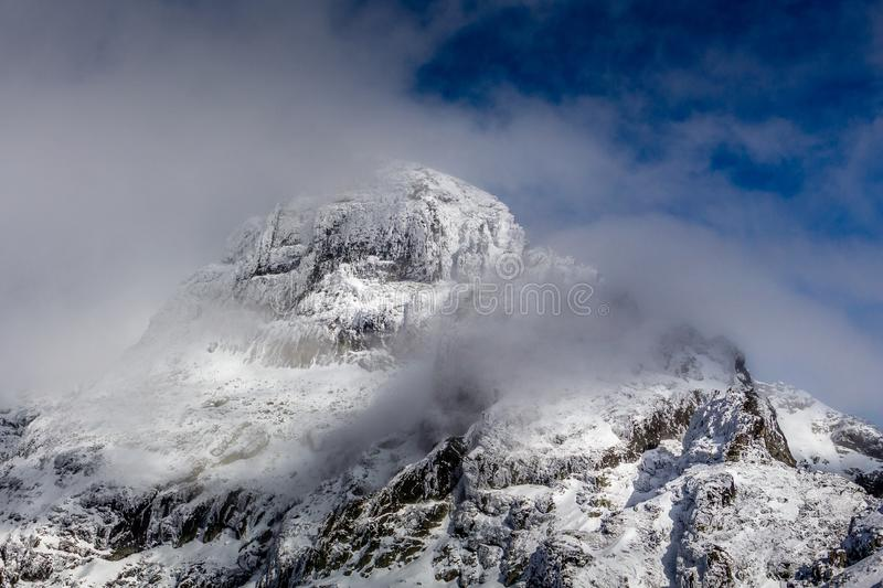 Summit in the mist of the clouds, Stunning landscape at Rila mountain in Bulgaria, Maliovica royalty free stock photo