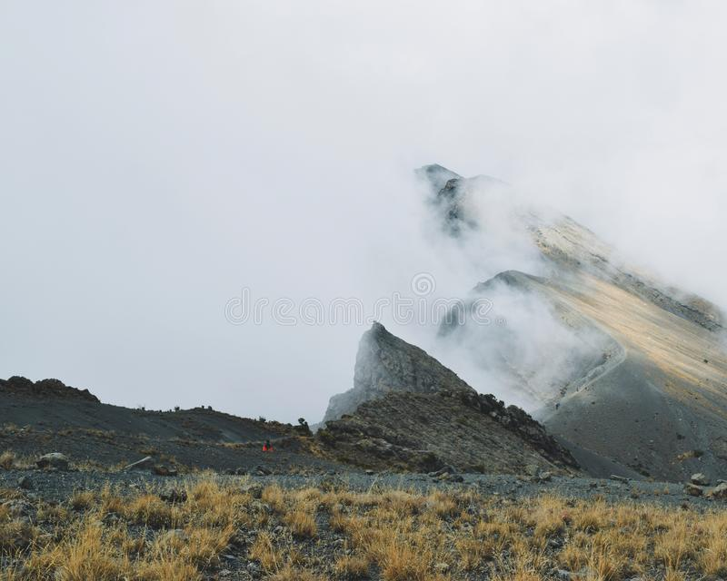 The summit of Mount Meru, Arusha National Park. Mount Meru, Arusha National Park partly covered by the clouds stock photography
