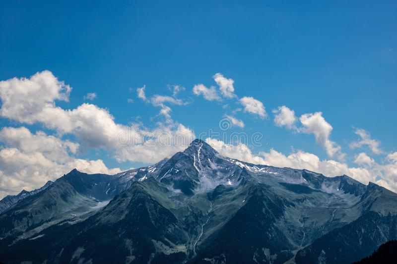 Summit of the mountain `Ahornberg` in zillertal/austria with rocks, green meadow royalty free stock photo
