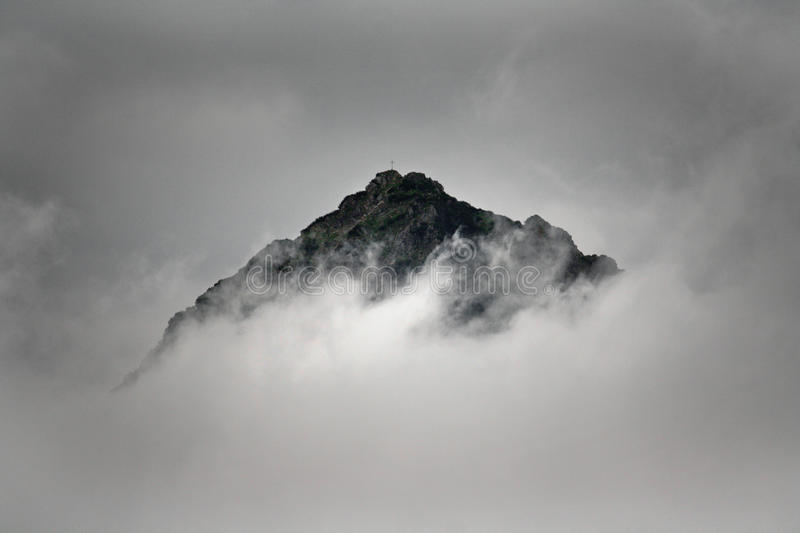 Summit of a mountain in the clouds stock image